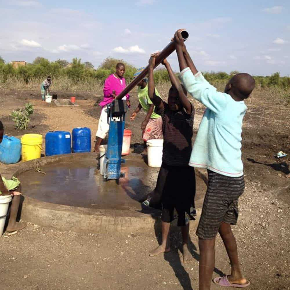 Children Drawing Water from borehole pump