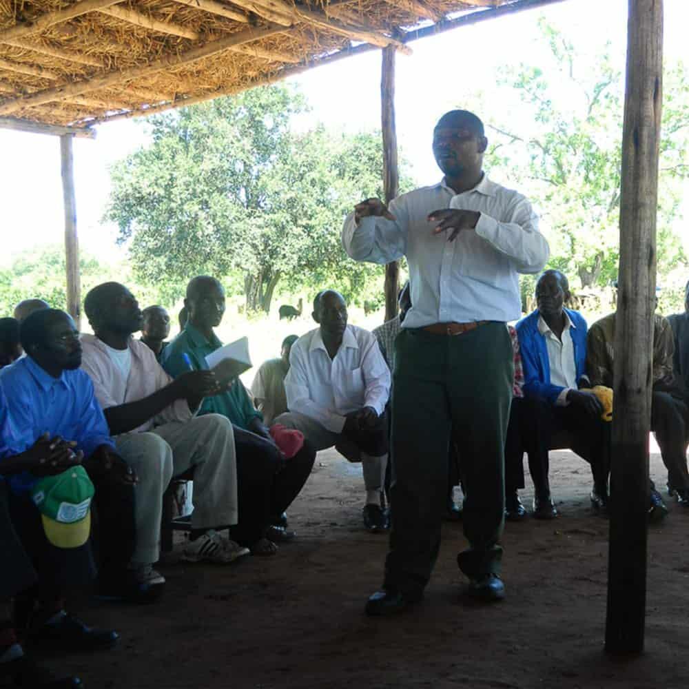 Man speaking at Village Meeting