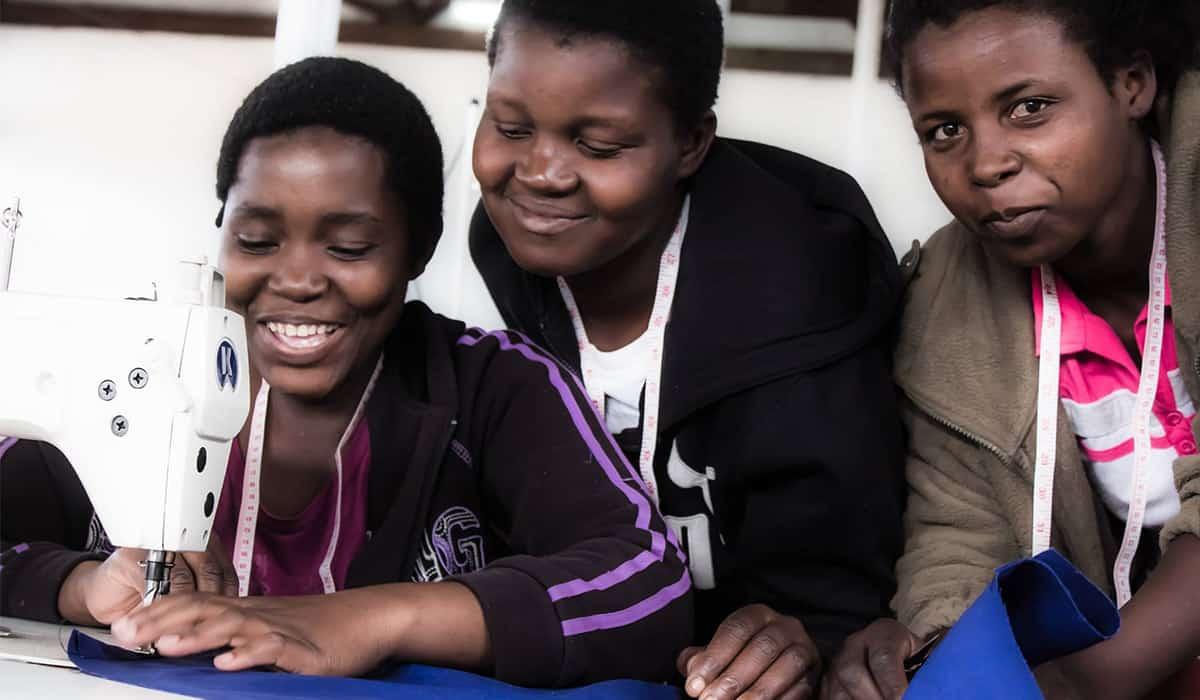 African women using sewing machine